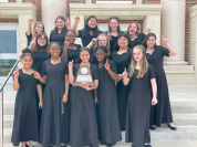 group of teen girls dressed up after choir performance