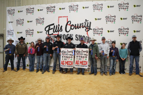 group of teens in front of livestock show backdrop