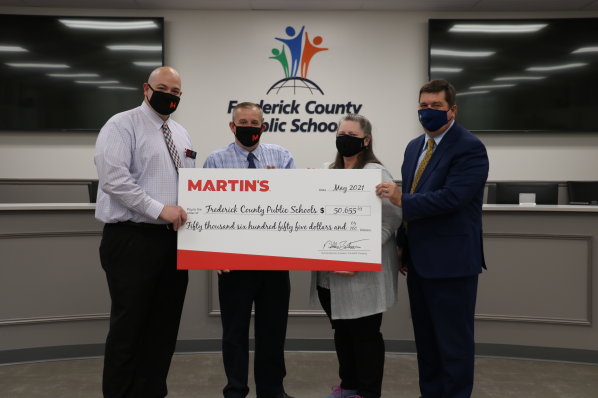 Bright Futures Nancy Mango and FCPS Superintendent Receive Check from Martins Food