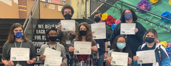 group of teens holding certificates