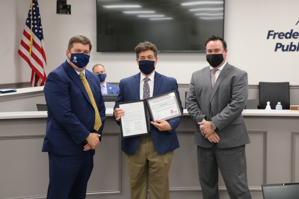 Dr. Sovine and Jay Foreman present certificates to Valley Health