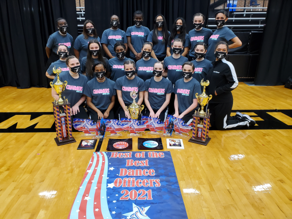 drill team in matching shirts pose with awards