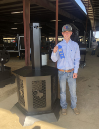 teen boy poses with blue ribbon